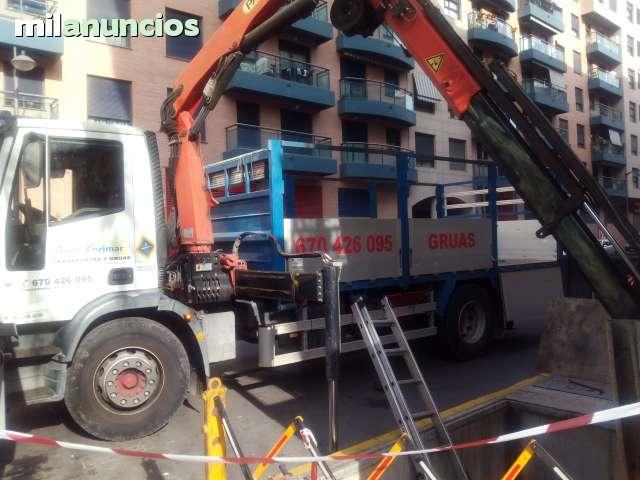 GRÚAS Y TRANSPORTES - foto 1