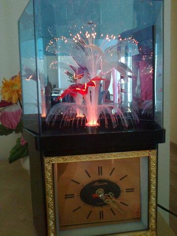 Reloj Con Flor Giratoria