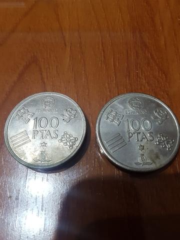 Moneda 100