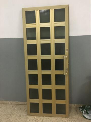 Puerta Aluminio.