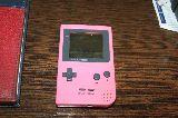 game boy pocket rosa con tapa - foto