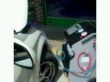Carga de gas A/C vehículos - foto