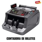 Maquina de contar billetes nueva. - foto