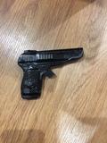pistola de juguete hojalata - foto