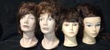 cuatro maniquÍ cabezas peluqueria - foto