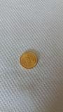 Moneda oro - foto