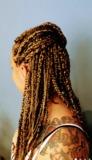 Extensiones de nudo y trenzas africanas - foto
