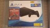 Consola Playstation 4 y juego Spiderman - foto
