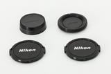 Lote Tapas Nikon - foto
