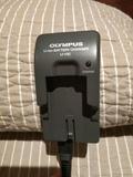 Cargador olympus - foto