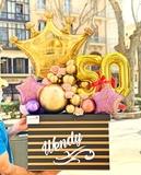 cajas sorpresas con globos - foto