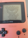 Game Boy Pocket rosa con juegos - foto