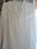 Blusa blanca y de otra de rayas - foto