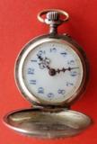 Reloj de bolsillo antiguo de plata - foto