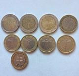 Monedas de dos y un euro - foto