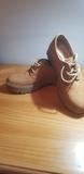 zapatos marrones - foto