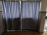 Se confecciona cortinas de toldo - foto