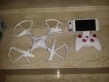 Dron wifi parada en aire y boton retorno - foto