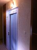 Ascensores, elevadores y básculas - foto