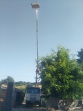 camion cesta fachadas tejados - foto