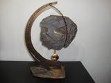 Reloj-escultura de arte romera - foto