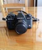 Cámara de fotos y objetivo - foto