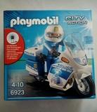 Policia en moto de playmobil - foto