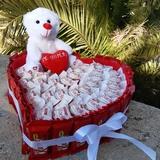 Corazón hecho de dulces - foto