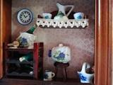 Cuadro de madera con miniaturas - foto