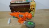 Dinosaurio teledirigido - foto
