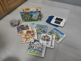 Nintendo 2DS con caja, cargador y juegos - foto