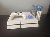 PS4 Blanca con 4 juegos - foto