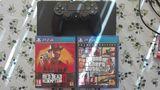 PS4 1 Tb + juegos - foto