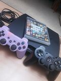 ps3 slim 120 GB + 2 mandos+ Gta 5 - foto
