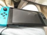 Switch con joycon y cargador - foto