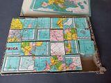 Antiguo puzzle de mapas - foto