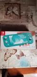 Nintendo Switch Lite más funda y juego. - foto