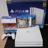 PS4 PRO +2 mandos y 2 juegos - foto