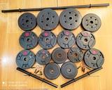Lote 39kilos  discos + barra + mancueras - foto