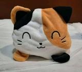 peluches de gatos reversibles - foto