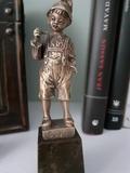 figura bronce - foto