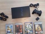 Playstation 2 con juegos - foto