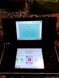 Nintendo DSi negra con su caja - foto