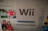 Wii seminueva con cuatro juegos - foto