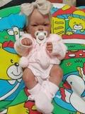 muñeca niña reboneada - foto